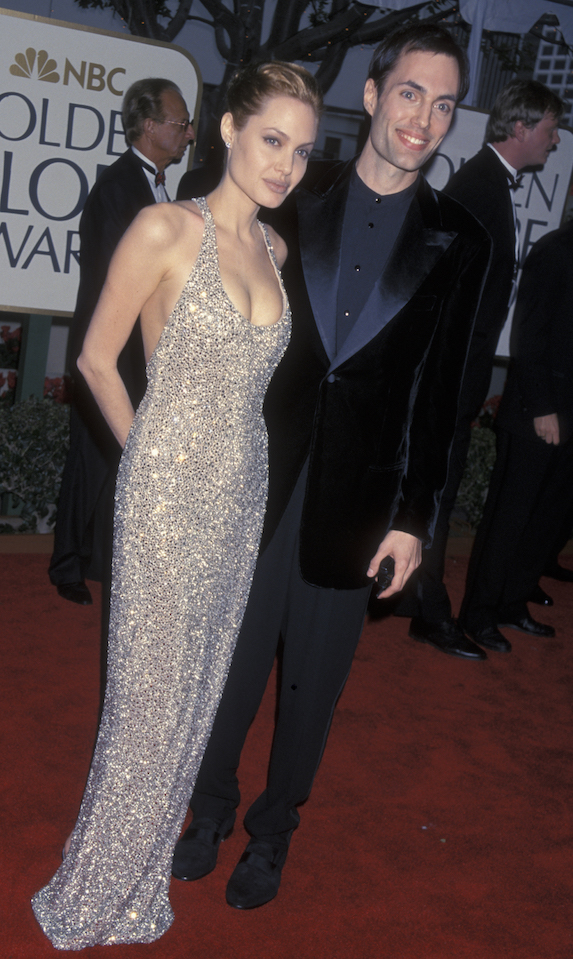 Angelina Jolie wears a sparkly halter-style gown to the Golden Globe Awards in 1999