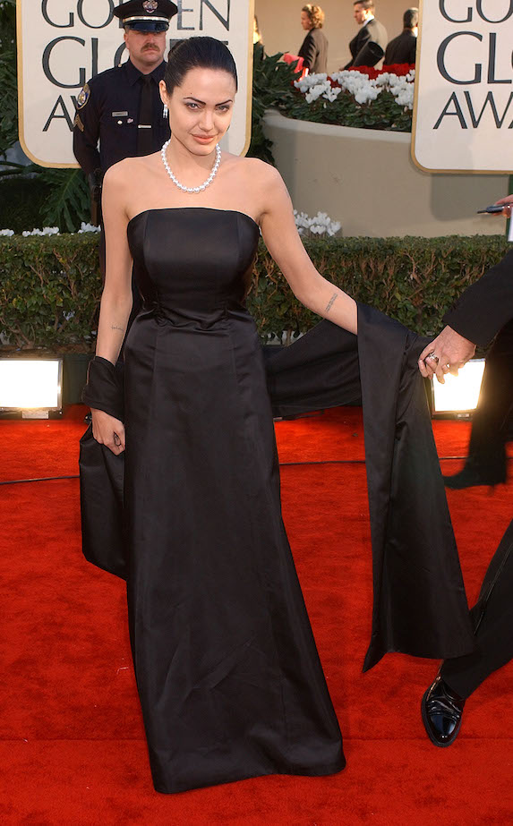 Angelina Jolie wears a strapless black gown to the 2002 Golden Globe Awards