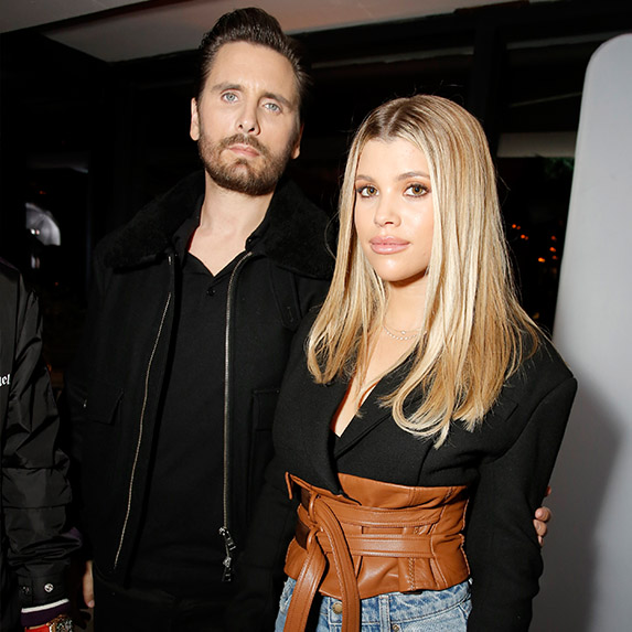 Scott Disick and Sofia Richie standing side by side