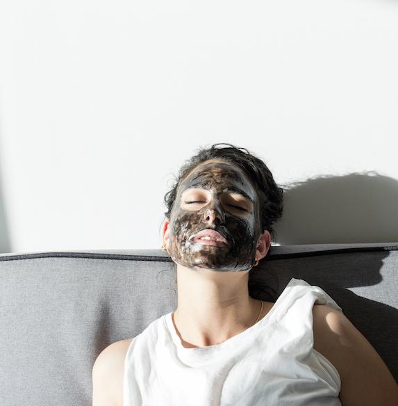 Woman wears beauty mask while sleeping