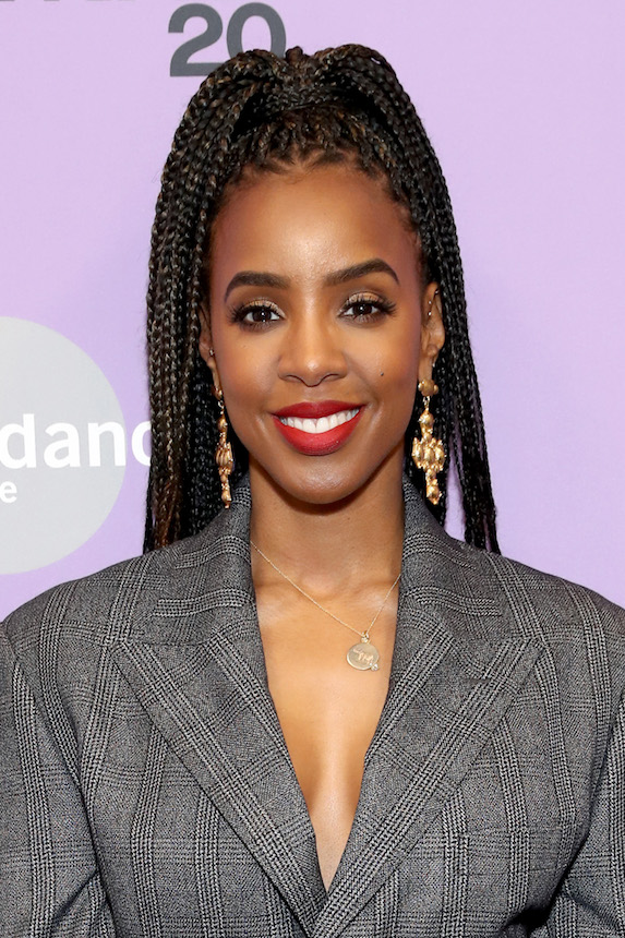 Kelly Rowland wears her hair in a braided ponytail