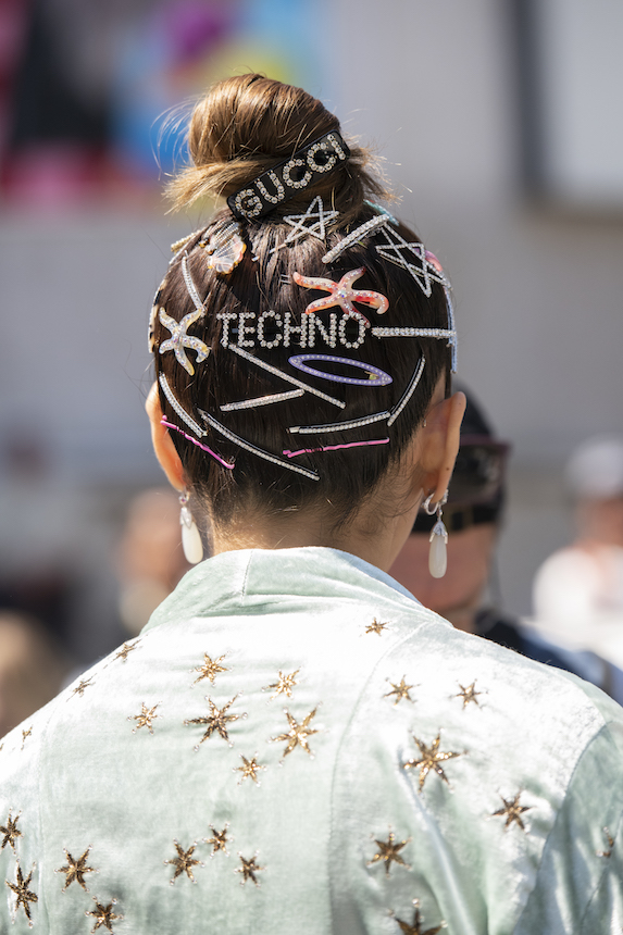 Hair adorned with a variety of hair clips and bejeweled pins