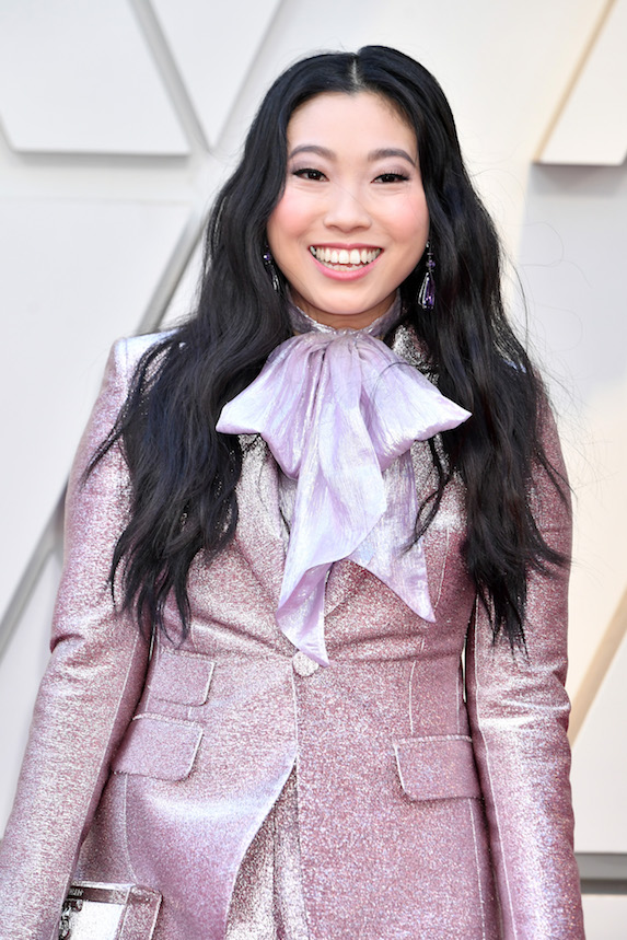 Awkwafina wears her hair in loose waves and a jet-black colour