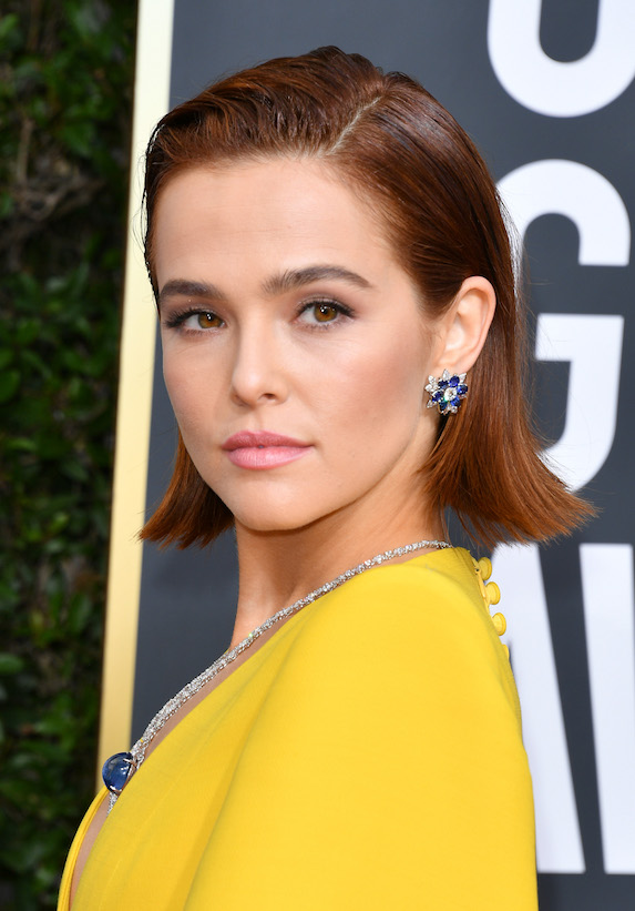 Actress Zoey Deutch wears her hair with a deep side part