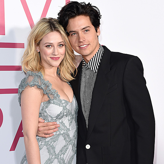Lilli Reinhart and Cole Sprouse standing together, and posing for the cameras