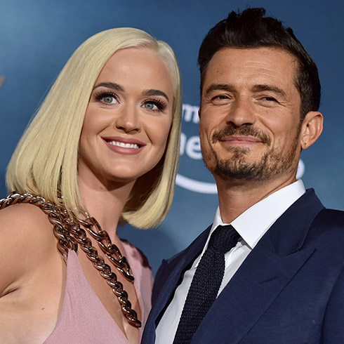 Katy Perry and Orlando Bloom smiling for cameras