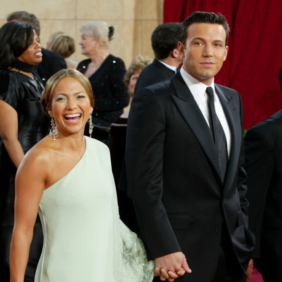 Ben Affleck and Jennifer Lopez smiling on the red carpet together at the 75th Annual Academy Awards