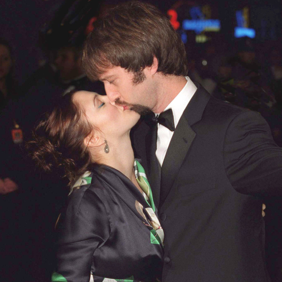 Drew Barrymore and Tom Green kissing at a Hollywood party