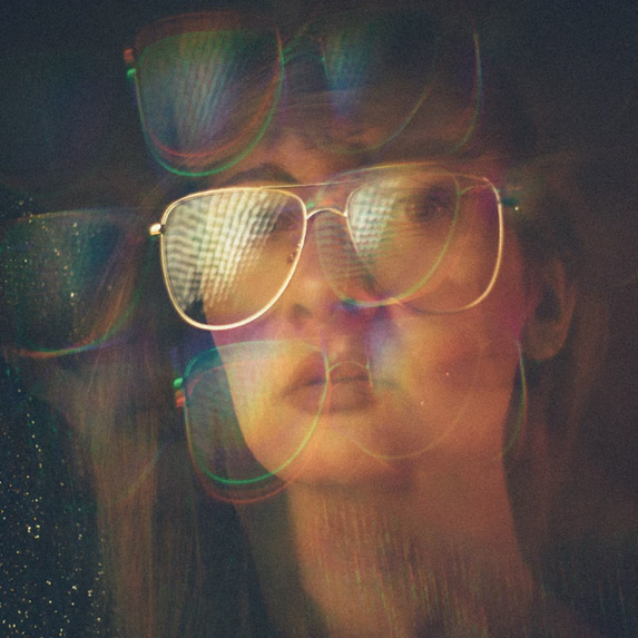 Cool image with girl and aviator shaped glasses on her face, 80's style