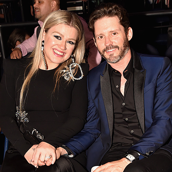 Kelly Clarkson and Brandon Blackstock, seated together and smiling