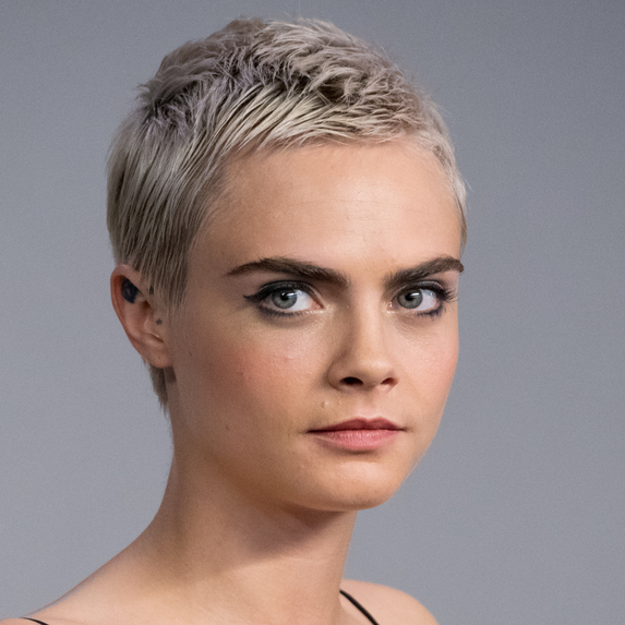 Close up of Cara Delevingne with a buzz cut