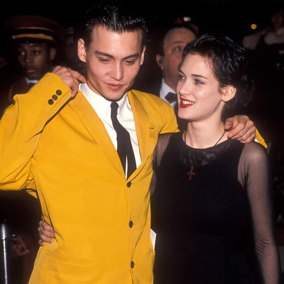 Johnny Depp and Winona Ryder smiling together at the Cry-Baby premiere