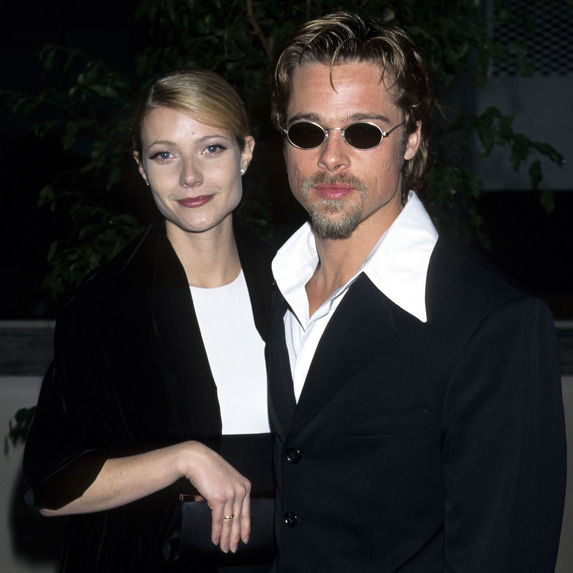Gwyneth Paltrow and Brad Pitt standing together as a couple at the 53rd Annual Golden Globe Awards