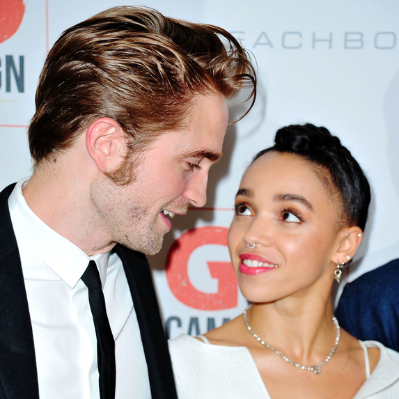 Robert Pattinson and FKA Twigs looking lovingly at each other while attending the 8th Annual GO Campaign Gala
