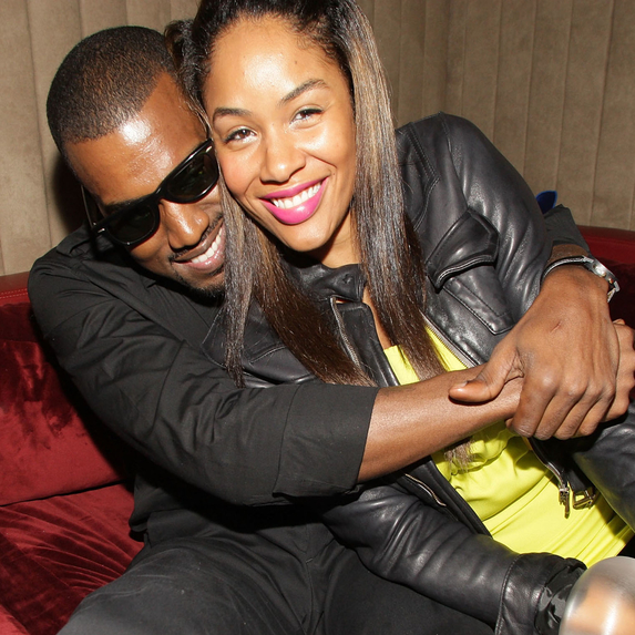 Kanye West holding Alexis Phifer at Us Weekly's 2007 Hot Hollywood party