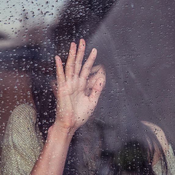Girl in rainy window