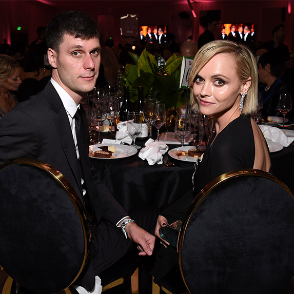 Christina Ricci and James Heerdegen sitting down at a formal dinner