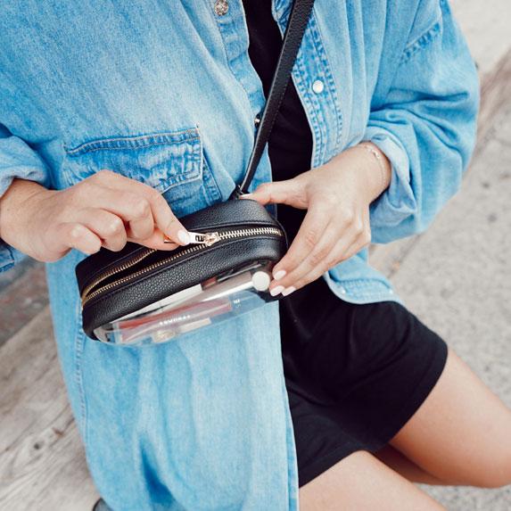 Woman unzipping her purse.