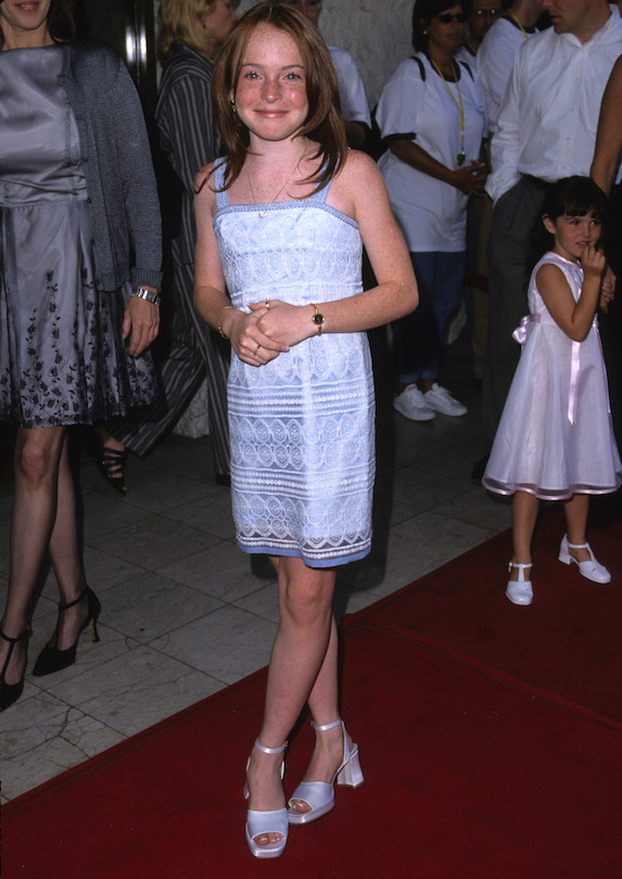 Lindsay Lohan wears a light-blue embroidered dress while attending a premiere in 1998