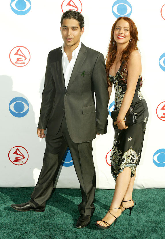 Lindsay Lohan wears a slip-style dress and strappy heels while attending an event with then-boyfriend Wilmer Valderrama in 2004