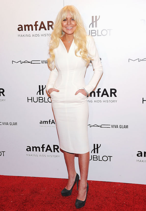 A platinum-haired Lindsay Lohan wears a white midi dress to an amfAR event in 2012
