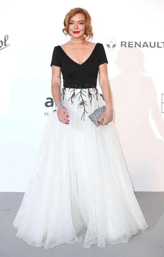 Lindsay Lohan wears a floor-length gown to an amfAR event in 2017