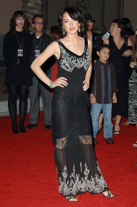 A brunette Lindsay Lohan wears a long, black gown and red lipstick to the American Music Awards in 2005