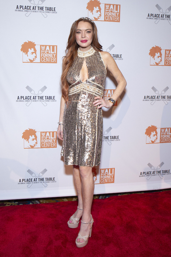 Lindsay Lohan wears a sparkly mini dress to a gala event in 2019