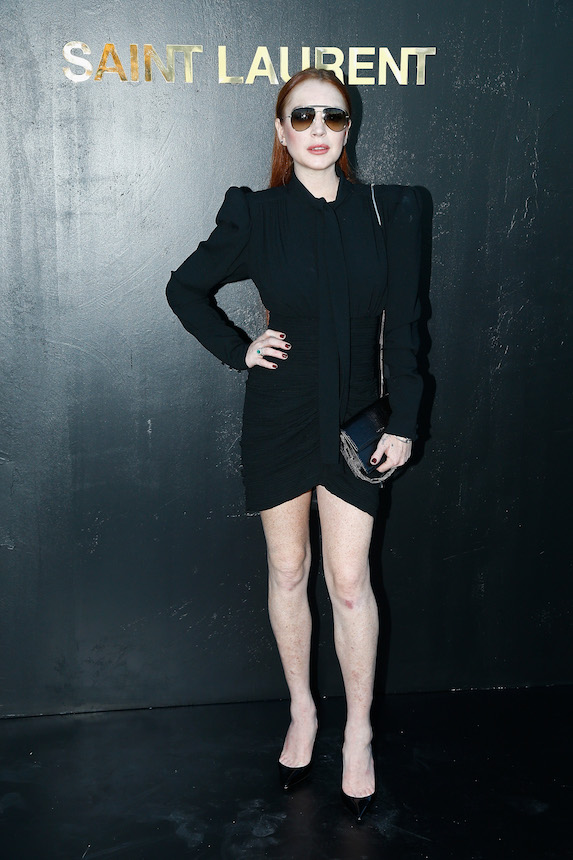 Lindsay Lohan wears an all-black ensemble to a fashion show in 2018