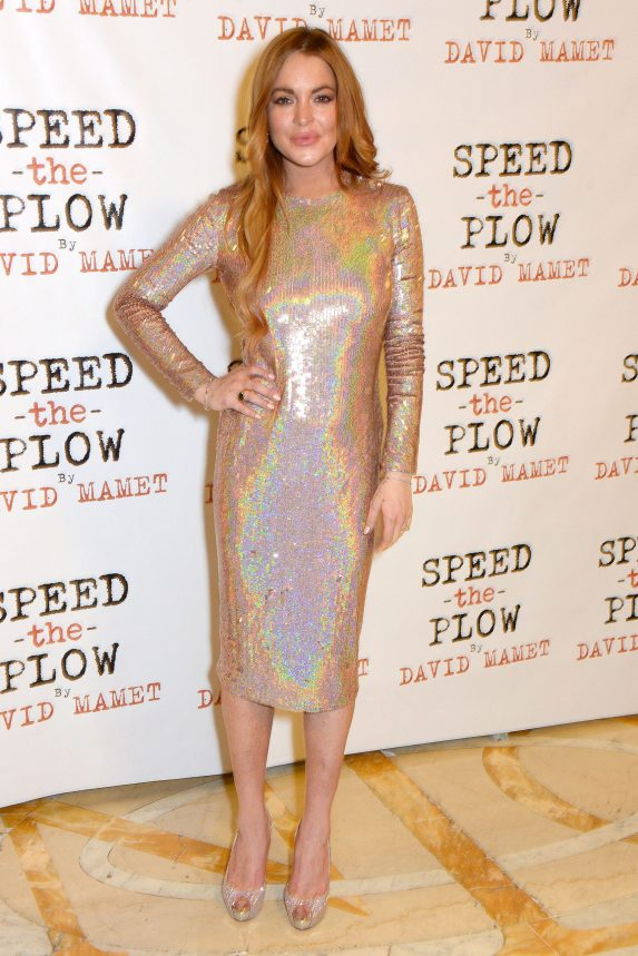 Lindsay Lohan wears a long-sleeved, iridescent dress to an after-party in 2014