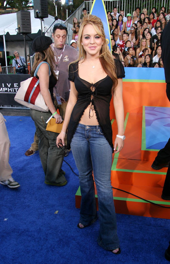 Lindsay Lohan wears a sheer black top and low-rise jeans to the 2003 Teen Choice Awards