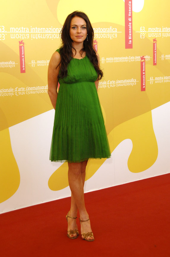 Lindsay Lohan wears a bright green mini dress to a photo call in 2006