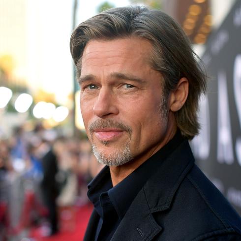 Brad Pitt standing on a red carpet