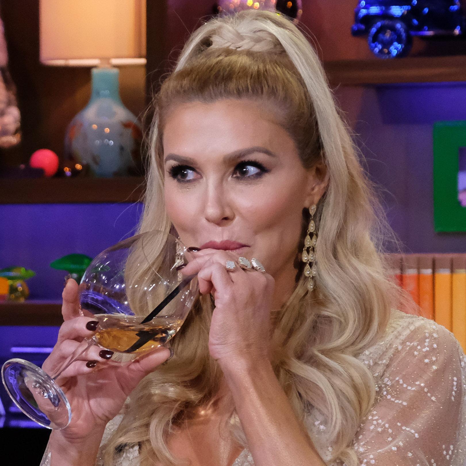 Brandi Glanville takes a drink