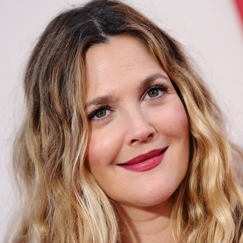Drew Barrymore looking at cameras in the distance on the red carpet