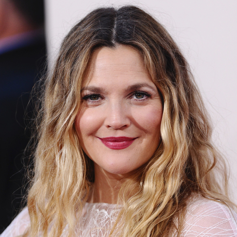 Drew Barrymore smiling for a camera