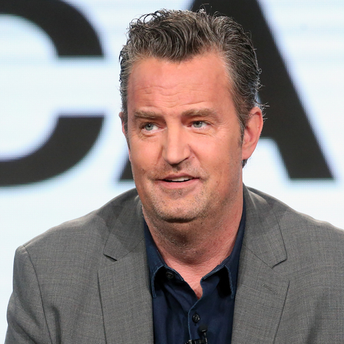 Matthew Perry speaking at an event