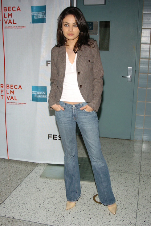 Mila Kunis wears a blazer, jeans and pointed-toe boots to the Tribeca Film Festival in 2004