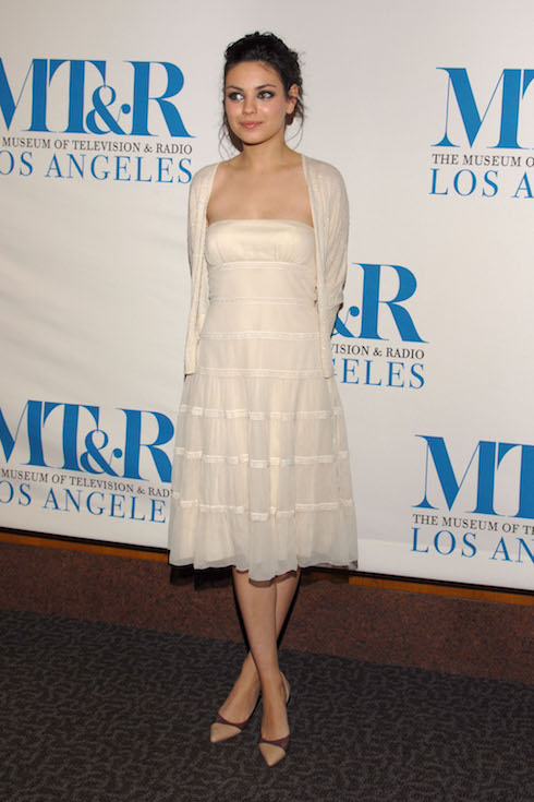 Mila Kunis wears a strapless dress and matching cardigan to an event in 2006