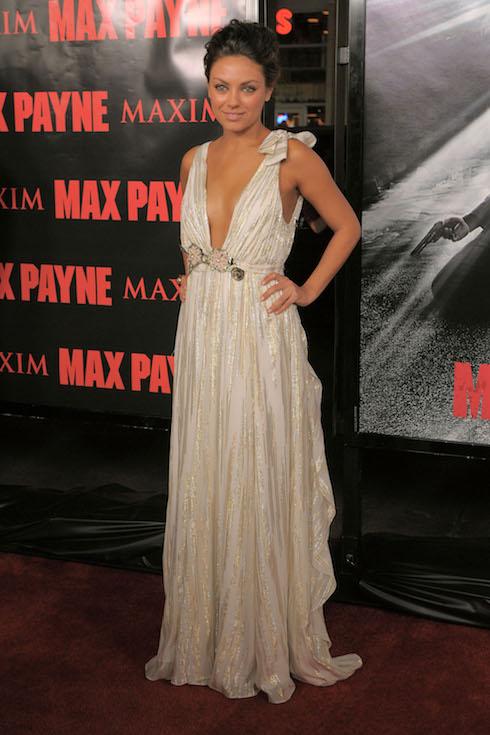 Mila Kunis wears a low-cut, floor-length gown to a film premiere in 2008