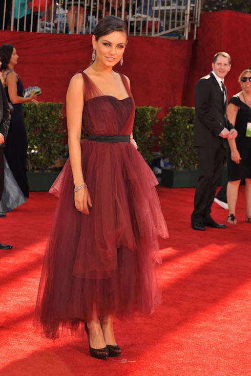 Mila Kunis wears a scarlet gown with tulle details to the 2009 Emmy Awards