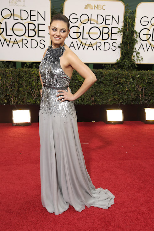 Mila Kunis wears a floor-length silver gown to the Golden Globe Awards in 2014