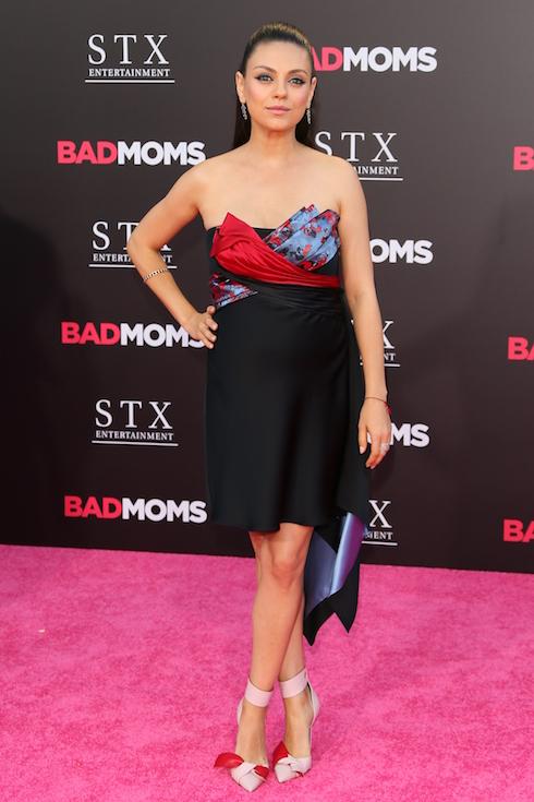 Mila Kunis wears a mini dress and strappy heels to a 2016 film premiere