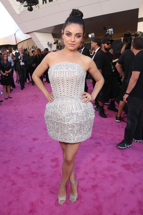 Mila Kunis wears a silver mini dress to the Billboard Music Awards in 2016