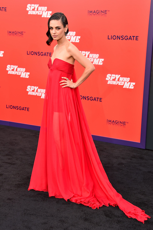 Mila Kunis wears a strapless red gown to a film premiere in 2018