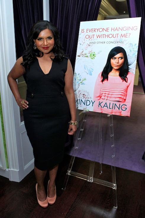 Mindy Kaling wears a black dress while promoting her new book in 2011