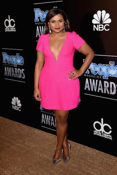 Mindy Kaling wears a bright pink mini dress for a press room photo op in 2014