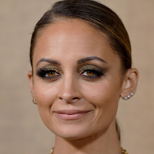 Nicole Richie smiling for the cameras at an event
