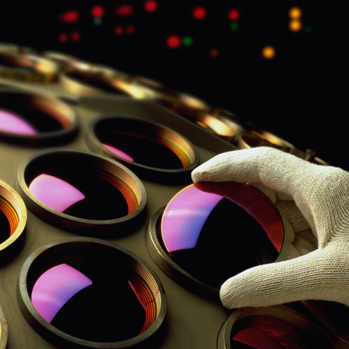 Optical engineer working with lenses