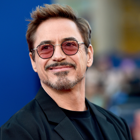 Robert Downey Jr. smiling on a red carpet